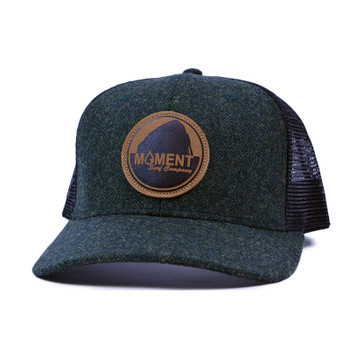 5aa2d830a29e79 Moment Bright Leather Patch Rock Herringbone Trucker Hat - Forest Green /  Black