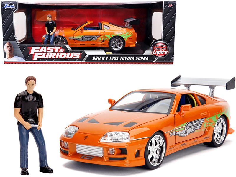 1995 Toyota Supra Orange Metallic Lights Brian Figurine Fast & Furious Movie 1/18 Diecast Model Car Jada 31139