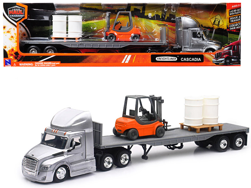 Freightliner Cascadia Silver with Flatbed Hauling Forklift, Pallet, and  Barrels