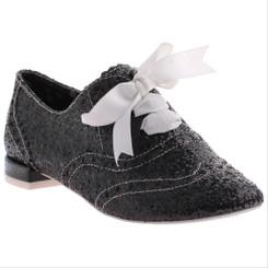 "Irregular Choice Gravitational Pull 2- Black, Black Glittered brogue with 1/2"" heel and white ribbon."
