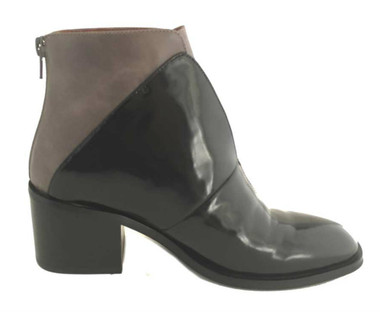 """Side View: Women's Shoes, Women's Boot, Jeffrey Campbell Jermaine. Two tone updated chelsea boot. 2.5"""" wood stacked heel. Color Black and Grey color block. Back Zipper. Size 7."""
