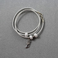 Kinetic Bracelet in White Leather With Silver Peace-Love-Music Charm