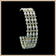 Diamond-cut Sterling Silver Barrel and Gold Bracelet
