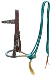 Showman ® leather bosal headstall with teal rawhide braided bosal and teal nylon mecate reins.