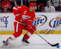 Nicklas Lidstrom Autographed 16x20 Photo #2 - Skating with Puck (horizontal)