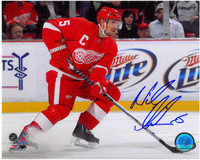 Nicklas Lidstrom Autographed 8x10 Photo #2 - Skating with Puck (horizontal)