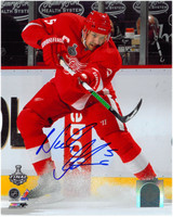 Nicklas Lidstrom Autographed 8x10 Photo #1 - Shooting Puck Ice Spray