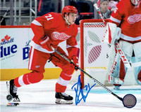 Dennis Cholowski Autographed 8x10 Photo #2 - Bringing the Puck Out