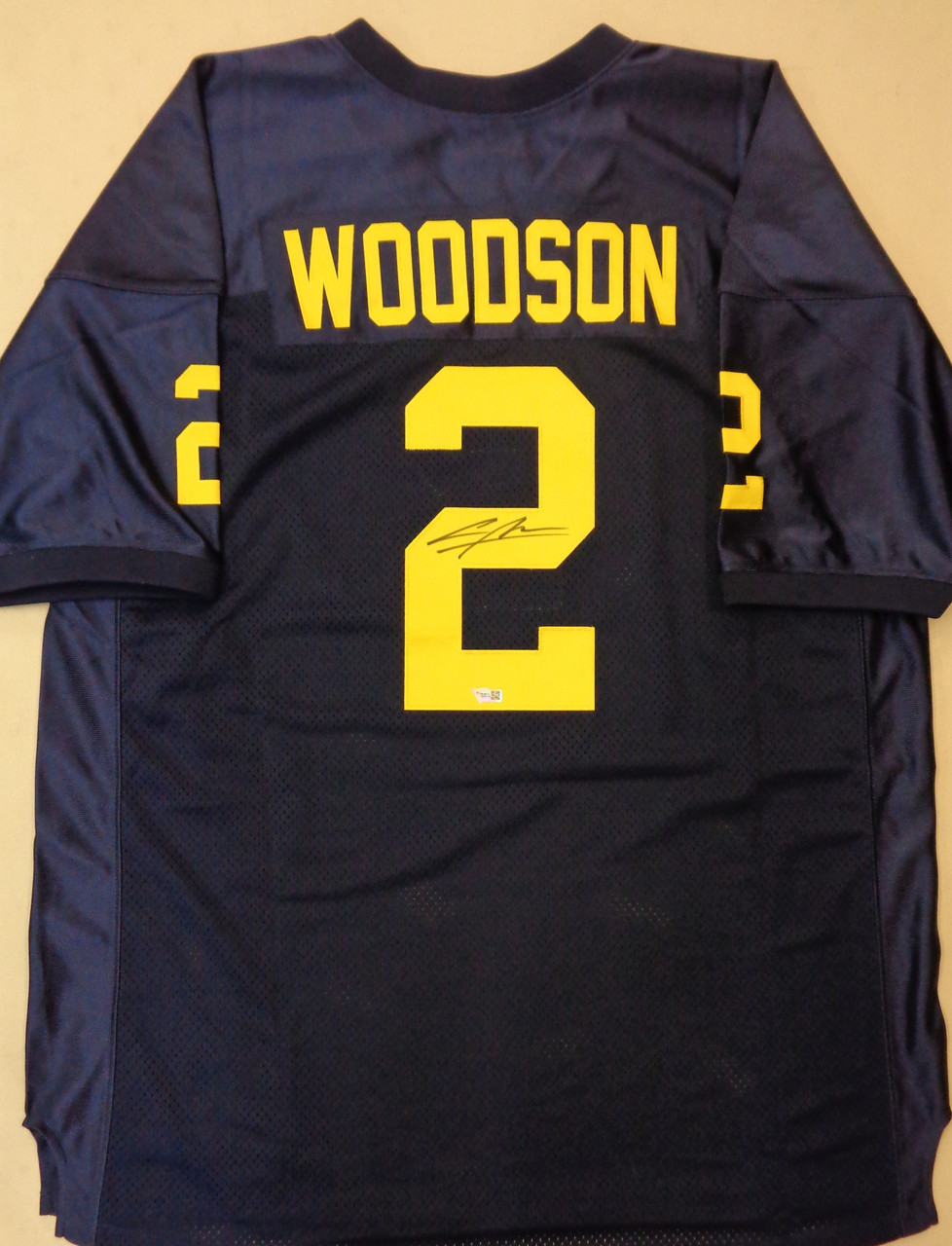 Charles Woodson Autographed 47 Brand University of Michigan Jersey