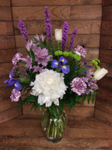Fresh mixed vase in purples lavenders and whites