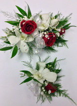 Red sweetheart and white orchid corsage and boutonnière combo
