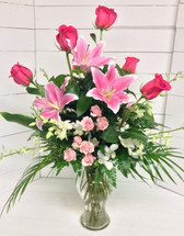 Orchids, Lilies, and Hot Pink Roses with Robellini Palms