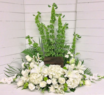 Classic Urn Adornment in Whites, Creams, and Greens