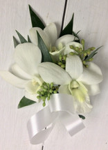 White orchids and white satin Boutonnière