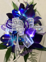 Bomb Blue Orchid wrist corsage with LED lights