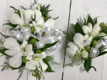 White Orchids and green berries Corsage and boutonnière combo