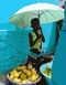 "Cape Verde  This colorful Cape Verde market scene features an abstracted photo of a young fruit vendor in Porto Novo proudly displaying her wares.   Cards measure 5-1/2"" by 4-1/4""; blank inside.  Set includes 8 cards and envelopes for $8.00.     Photo © 2008 John Earle (with Photoshop enhancement)"
