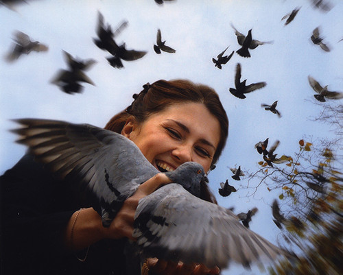Ukraine  A Ukrainian girl takes delight in releasing her pigeons.  Photo © 2009 Yuri Chernevyy; the International Calendar Project