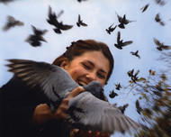 Ukraine  A Ukrainian girl takes delight in releasing her pigeons.  Photo © 2009 Yuri Chernevyy; the International Calendar Project