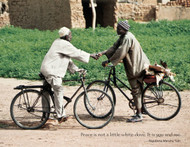 Burkina Faso  Two men approach each other on bicycles. They have other places to go but still find time to stop and shake hands, not once, but nearly a dozen times as they inquire about the health and happiness of each other's family. Handshaking is more than a superficial greeting in Burkina Faso. It reflects the deep cultural belief that strong bonds of friendship and family take precedence over all else. No matter how busy life is, there is always time for a handshake.  Photo © 2003 Matt McClure; featured in the 2006 International Calendar