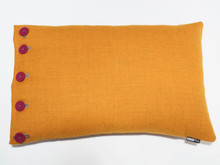 Fabulous Tangerine marle wool with hand stitched hot pink buttons creates a vibrant rectangular cushion.  A great addition for you home.  Combine with other colours from the Button Me range or opt for neutrals in the Hip To Be Square range for a sophisticated look. 60 x 40cm is perfect for placement on sofas or your bed. Feather filled insert.  All proudly made in Melbourne.