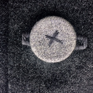 Detail of hand stitched button in pale ASH grey.  Perfect on this charcoal marle wool. 60x40cm, feather insert. Would look fabulous with Panel Me Crazy in Sepia or Classic Velvet in Ash.