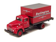 Red short box truck with white lettering