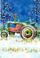 green garden tractor draped with the American Flag