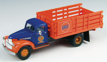 Blue cab with orange fenders and orange stake bed. Gulf Oil logo on the door of the cab.