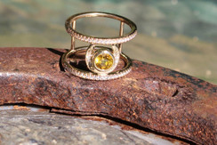14k gold horse shoe ring with diamonds and yellow sapphire
