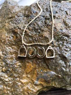 14k gold horseshoes and stirrups pendant