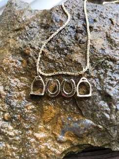 14K gold horseshoes and stirrups pendant