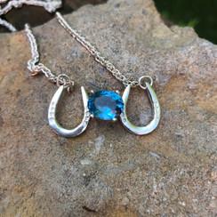 Horseshoe necklace with gemstones