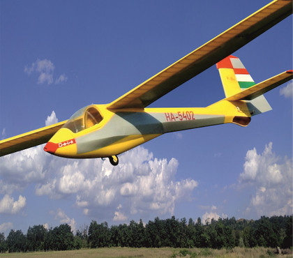 """The R-26s """"Góbé"""" is the most popular glider trainer in Hungary. For 5 decades, everybody had their first flights in one of these. Generations of pilots learned to fly on these. This glider was designed by Rubik Ernő Senior, who was the father of the inventor of the famous """"Rubik's cube"""". He is the most successful airplane designer in Hungary. He designed 28 different gliders and 5 powered aircraft. He had his own factory, where he manufactured these. This 1:7 scale model was designed by Pásztor Gábor in 2020. The model has a lot of scale detail, and it flies just as great as the original. It has a very nice glide slope and behaves very predictable, like a real trainer!"""