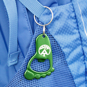 Foot keychain and bottle opener with the ATC logo.