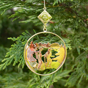 "This 2.25"" round ornament features two hikers, a lake, and ridges in the background dangling below the A.T. diamond logo."