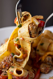 "Saucy, Italian ""Drunken"" Noodles w/ Spicy Italian Sausage, Tomatoes, Caramelized Onions, Red & Yellow Bell Peppers, with Fresh Basil"