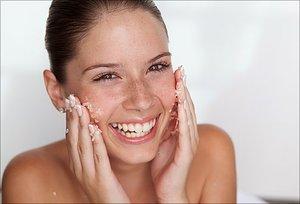 Girl scrubbing face with PureLx Micro-Dermabrasion Scrub