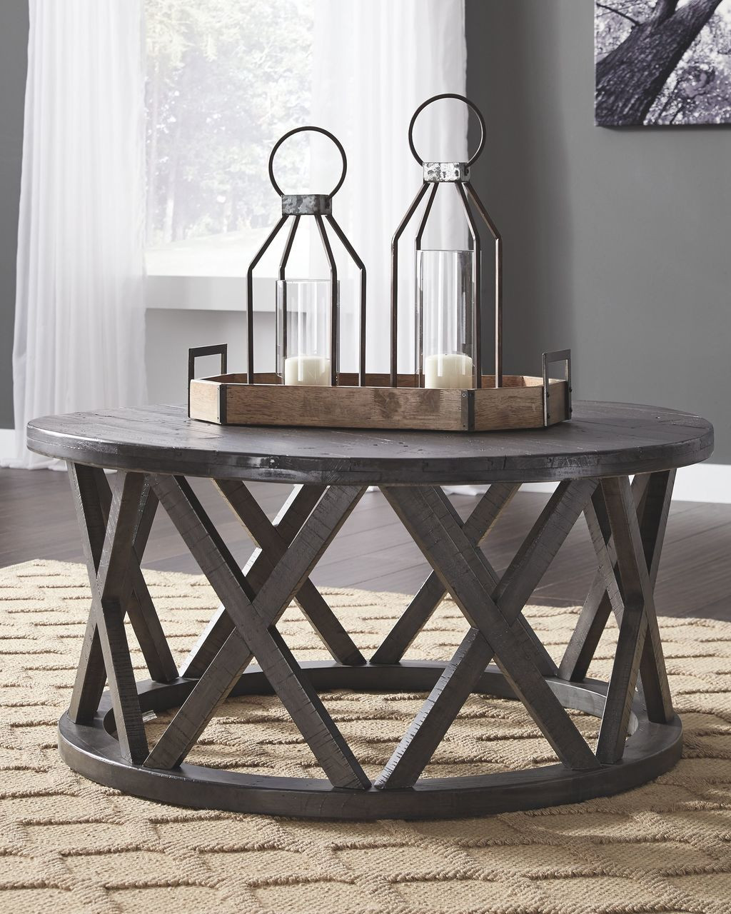 The Sharzane Grayish Brown Round Cocktail Table Available