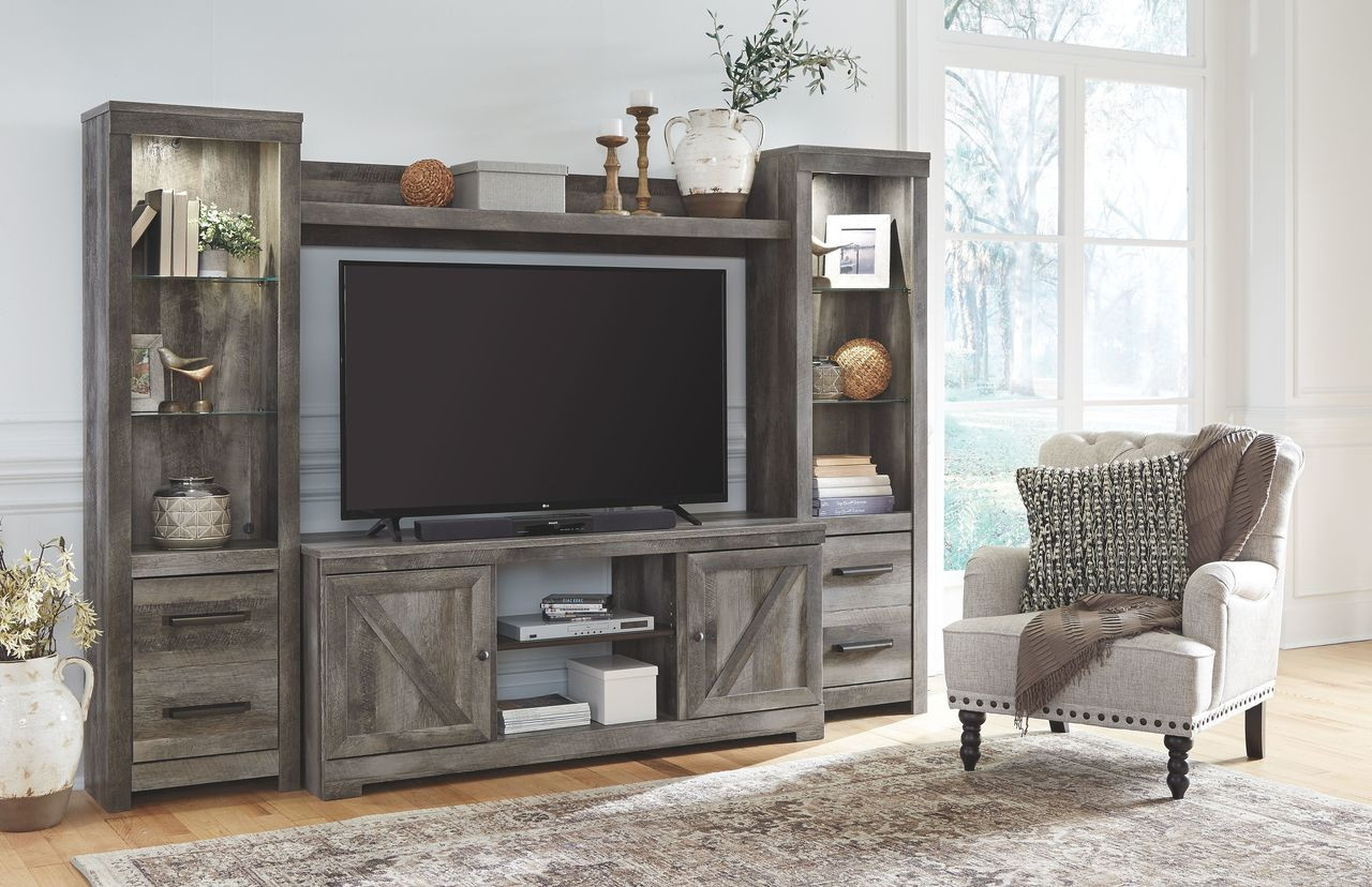 The Wynnlow Gray Entertainment Center Lg Tv Stand 2 Piers With Bridge Available At Furniture Direct Serving Hattiesburg Ms And Surrounding Areas