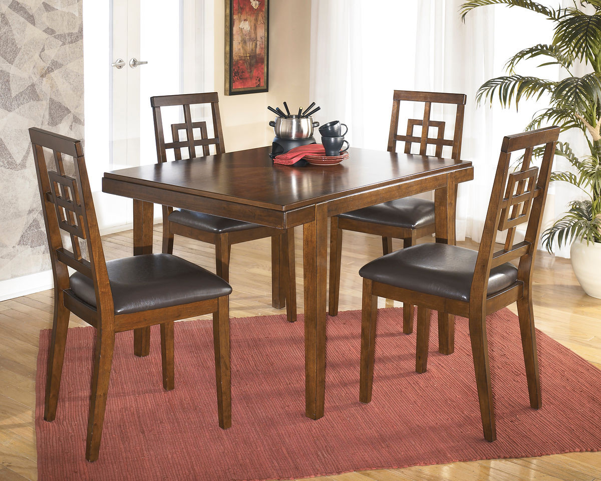 The Cimeran Medium Brown Reclining Dining Room Table Set Available At Furniture Direct Serving Hattiesburg Ms And Surrounding Areas