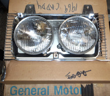 1969 Cadillac NOS Headlamp door