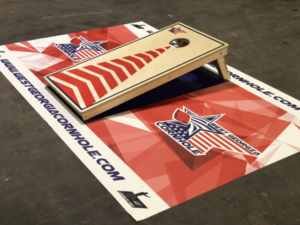 West Georgia Cornhole Launch Pad. It's the best custom mat for putting under your cornhole boards. It's a great replacement for the outdated carpet that so many have used for far too long. The Launch pad is the best cornhole pitching pad you can find on the market. It's great for cornhole tournaments, sponsored cornhole tournaments, ACL cornhole championships, and cornhole livestreams. You can design your own mat with your very own logo and design.