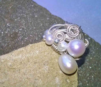 R00014 - White Potato and Rice Pearls in a 925 Sterling Silver contemporary cluster and swirl design in size O