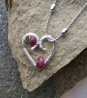 "Passion for pink? then this is for you...encrusted Silver Plated contemporary heart woven with beautiful pink Sapphires on a 22"" .925 Sterling Silver chain, don'tforget it's the birth stone for September!"