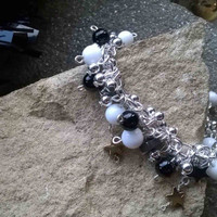 A cluster style .925 Sterling Silver bracelet made from Alabaster, Haematite stars, Onyx, and Quartz with lots of movement for that added sparkle. Length 7""