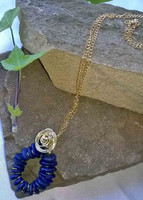Circular and coiled Lapis Lazuli pendant on chain, accented with gold coloured wire