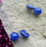 """He has lots of cufflinks""  I can guarantee he won't have these! Ocean blues and golden flecks, these Lapis Lazuli gemstones are mezmerising. One side is round, the other flat, they work perfectly together not only good looking but practical too"