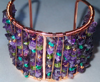 Wonderous contrasting hues that really work. The Greens from the Pearls and Peridots, Purples from the Amethyst bounce off the bright Copper cuff frame, they really ignite! Contemporary in design, neat in style and very easy to wear.