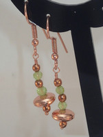 Bright copper 4cm drop earrings with wonderful lime green faceted Peridots, they look superb with the matching necklace...full of movement!